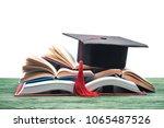 graduation cap on stack of open ...   Shutterstock . vector #1065487526