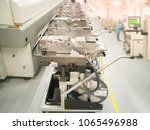 Small photo of Prepare component loading on table for machine SMT at surface Mount Technology (SMT) for manufacturing of electronic equipment, blur background