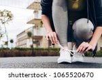a sporty young girl assiduously ... | Shutterstock . vector #1065520670