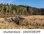 wreck of a small boat on the... | Shutterstock . vector #1065538199