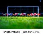 football ball on green grass... | Shutterstock . vector #1065543248