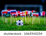 football ball on green grass... | Shutterstock . vector #1065543254