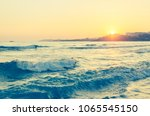 beautiful sunset over sea with... | Shutterstock . vector #1065545150