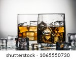 whiskey in a glass with ice on... | Shutterstock . vector #1065550730
