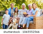 three generation family petting ... | Shutterstock . vector #1065552566