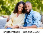 happy young black couple... | Shutterstock . vector #1065552620