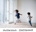 young black boys polaying in... | Shutterstock . vector #1065564449