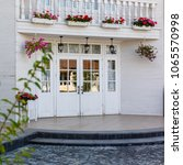 white front door with small... | Shutterstock . vector #1065570998