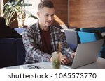 young freelancer working with... | Shutterstock . vector #1065573770