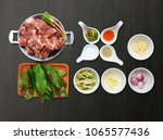 boiled pork in the chamuang... | Shutterstock . vector #1065577436