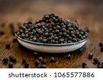 close up of black peppercorns... | Shutterstock . vector #1065577886