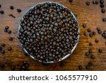 close up of black peppercorns...   Shutterstock . vector #1065577910