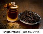 close up of black peppercorns... | Shutterstock . vector #1065577946