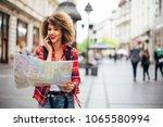 young beautiful female traveler ... | Shutterstock . vector #1065580994