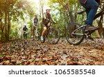 group of friends ride mountain... | Shutterstock . vector #1065585548