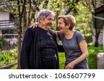 very old woman with her... | Shutterstock . vector #1065607799