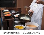pour the egg into the pan   Shutterstock . vector #1065609749