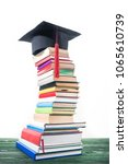 graduation cap on bent tower of ... | Shutterstock . vector #1065610739