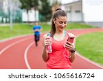 active young woman using phone... | Shutterstock . vector #1065616724