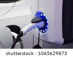 electric vehicle charging... | Shutterstock . vector #1065629873