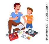 father and son building...   Shutterstock .eps vector #1065638054