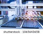 robot with vacuum suckers with... | Shutterstock . vector #1065643658