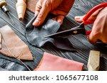 work in leather shop on dark... | Shutterstock . vector #1065677108