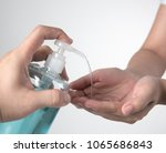 woman hand take alcohol... | Shutterstock . vector #1065686843