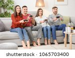 young people playing video... | Shutterstock . vector #1065703400