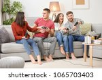 young people playing video... | Shutterstock . vector #1065703403