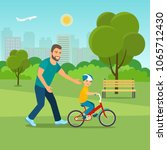 dad teaches his son to ride a... | Shutterstock .eps vector #1065712430