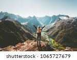 woman traveler raised arms... | Shutterstock . vector #1065727679