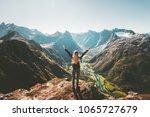 woman traveler raised arms... | Shutterstock . vector #1065727679