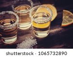 tequila shots with lime fruit... | Shutterstock . vector #1065732890