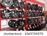 shelves with alloy wheels and... | Shutterstock . vector #1065734570