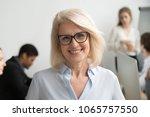 portrait of smiling senior... | Shutterstock . vector #1065757550