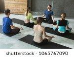 yoga teacher and beginners in...   Shutterstock . vector #1065767090