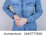 stomach ache concept. cropped... | Shutterstock . vector #1065777830