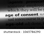 Small photo of age of consent word in a dictionary. age of consent concept.