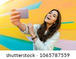 hipster woman taking selfie... | Shutterstock . vector #1065787559