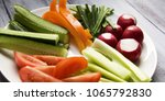 white plate with vegetables for ... | Shutterstock . vector #1065792830