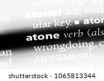Small photo of atone word in a dictionary. atone concept.