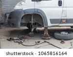 repair of a front wheel of a... | Shutterstock . vector #1065816164