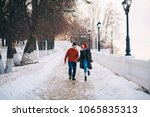 a loving young couple walks... | Shutterstock . vector #1065835313