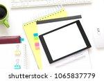 white desk  tablet pc  lying on ...   Shutterstock . vector #1065837779