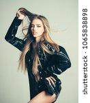 girl with long hair wears black ... | Shutterstock . vector #1065838898