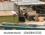white man wearing overalls... | Shutterstock . vector #1065841520