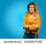 beautiful young woman nervous... | Shutterstock . vector #1065847430