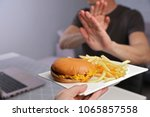 man refuses to eat junk food .... | Shutterstock . vector #1065857558