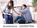 husband repairing broken table... | Shutterstock . vector #1065857906